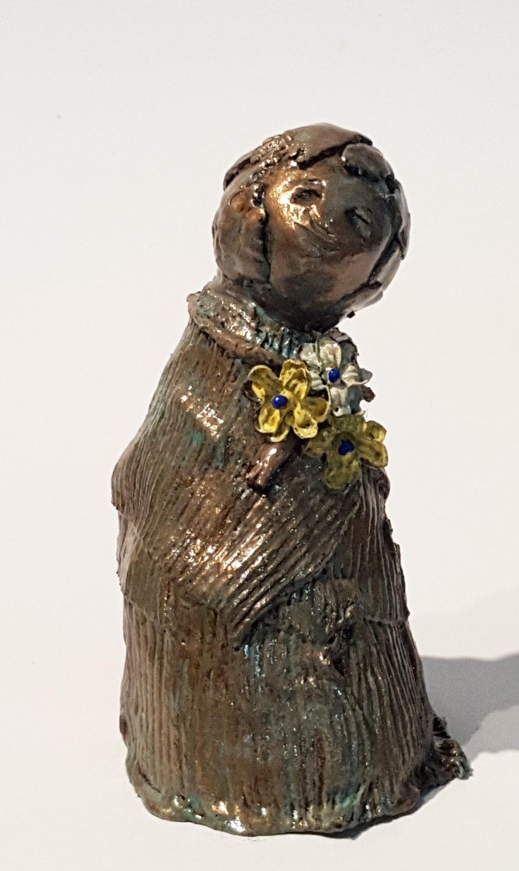 bronze child w flowers 2 front rt.jpg