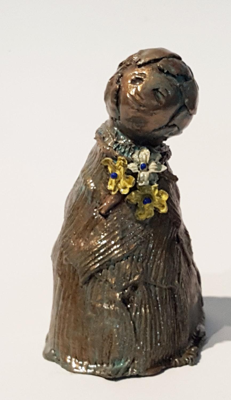 bronze child w flowers 2 front.jpg