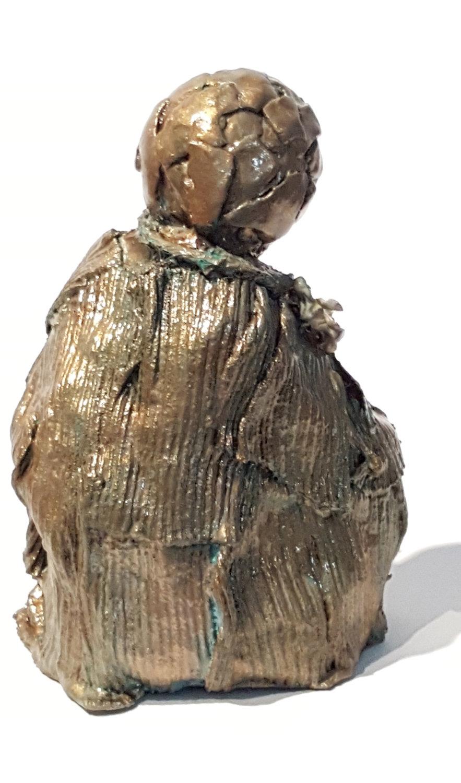 bronze child w flowers 3 back.jpg