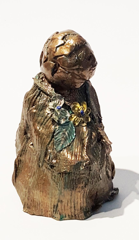 bronze child w flowers 3 rt front.jpg