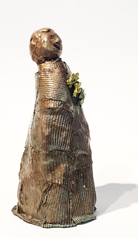 bronze child w flowers 5 rt side.jpg