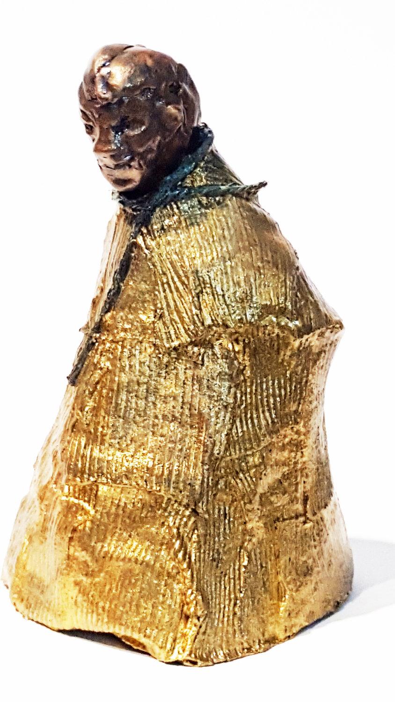 bronze figures man in gold robe front left.jpg