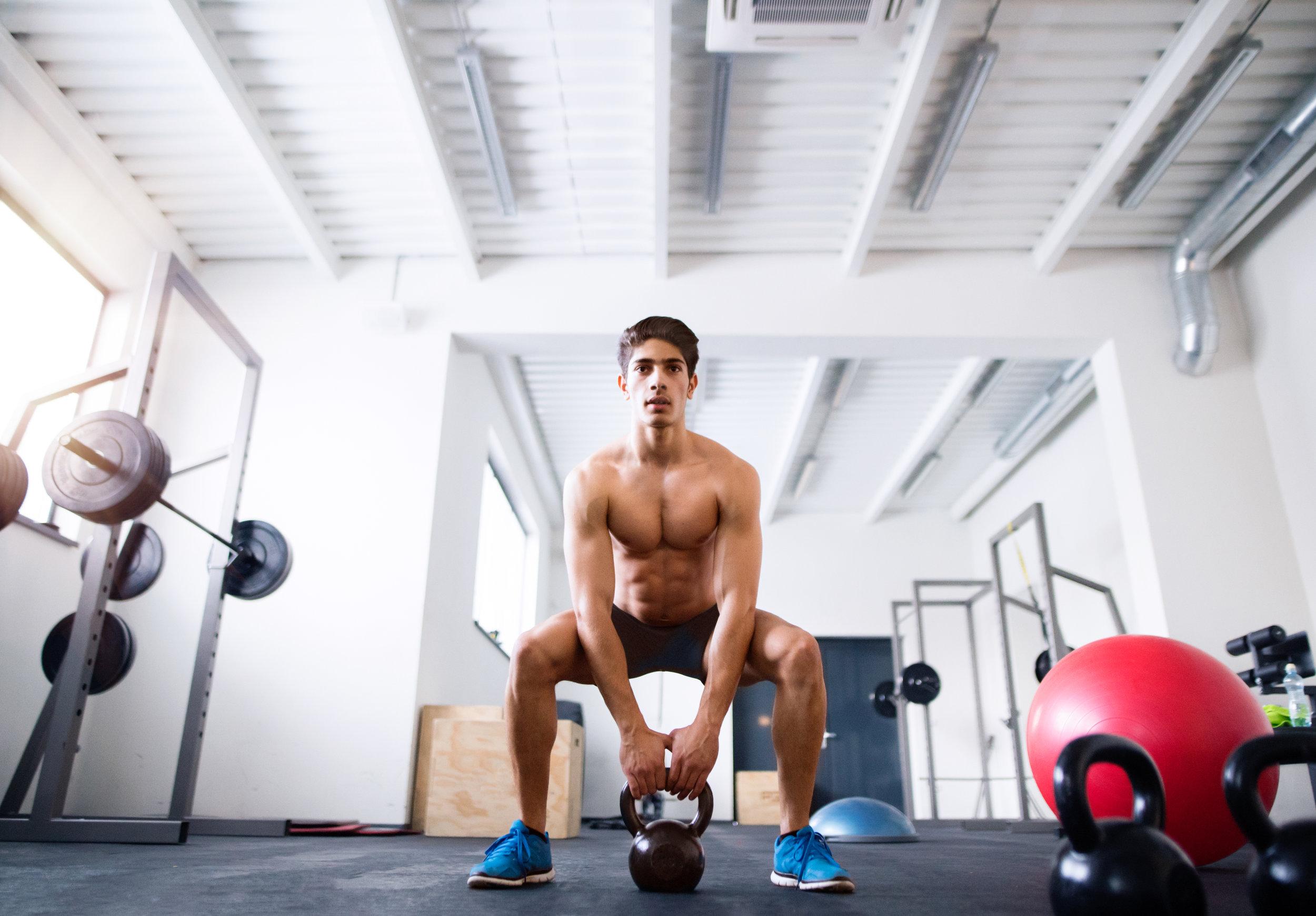 graphicstock-fit-hispanic-man-doing-strength-training-doing-kettlebell-swings-in-crossfit-gym_HdpUKiLMb.jpg