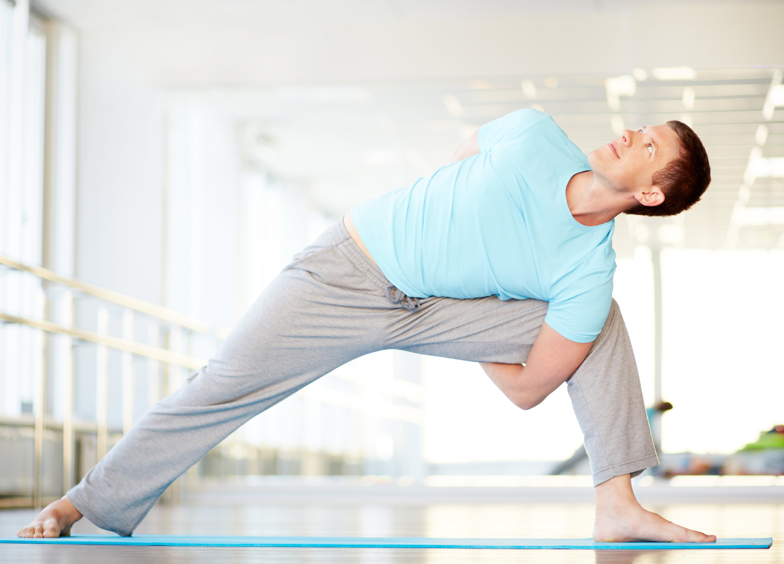graphicstock-portrait-of-young-man-doing-stretching-exercise-in-gym_Bgas_l-x-.jpg