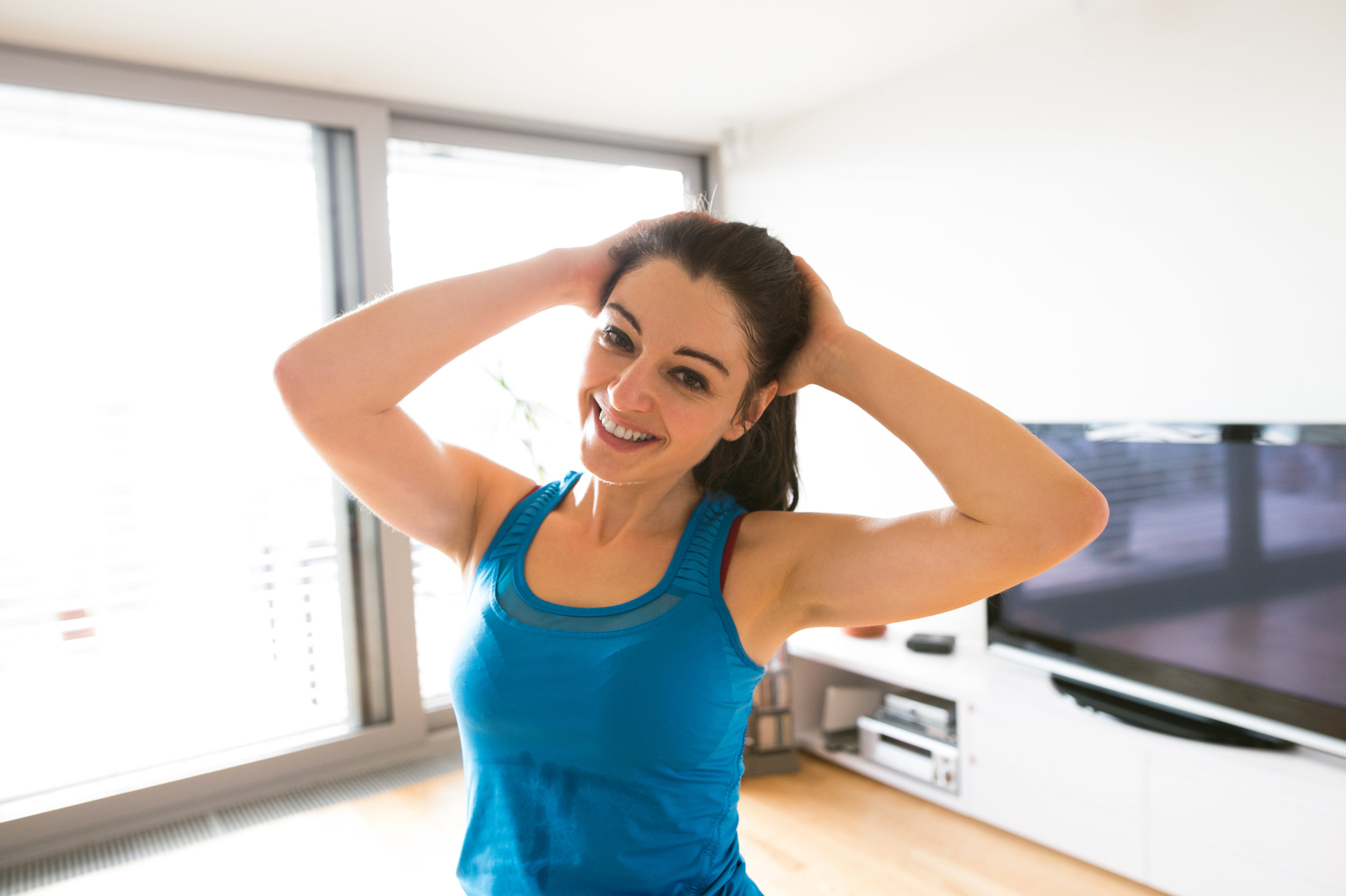 graphicstock-beautiful-young-woman-working-out-at-home-in-living-room-doing-yoga-or-pilates-exercise-stretching-neck_Bdgj44uIGb.jpg