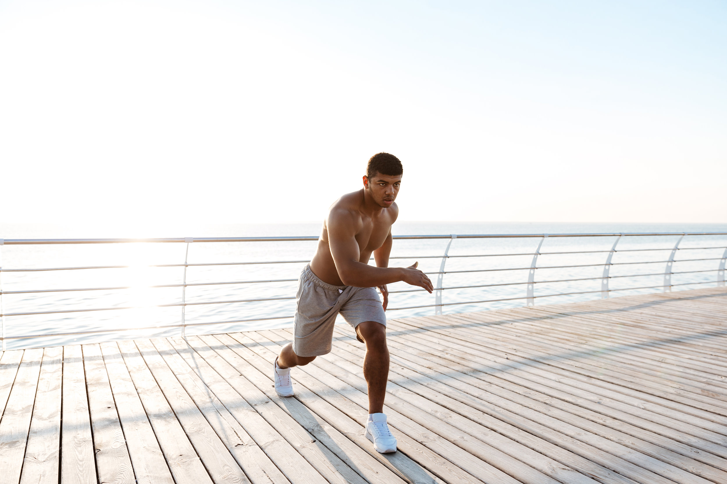 graphicstock-young-shirtless-afro-american-sportsman-doing-squats-on-the-pier-in-the-morning_BO_NVOuHhx.jpg