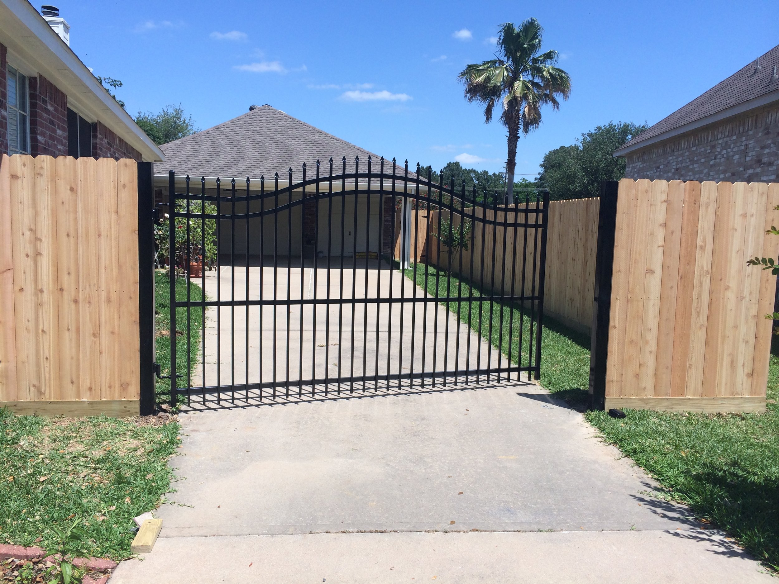 Custom powder-coated arched steel entry gate