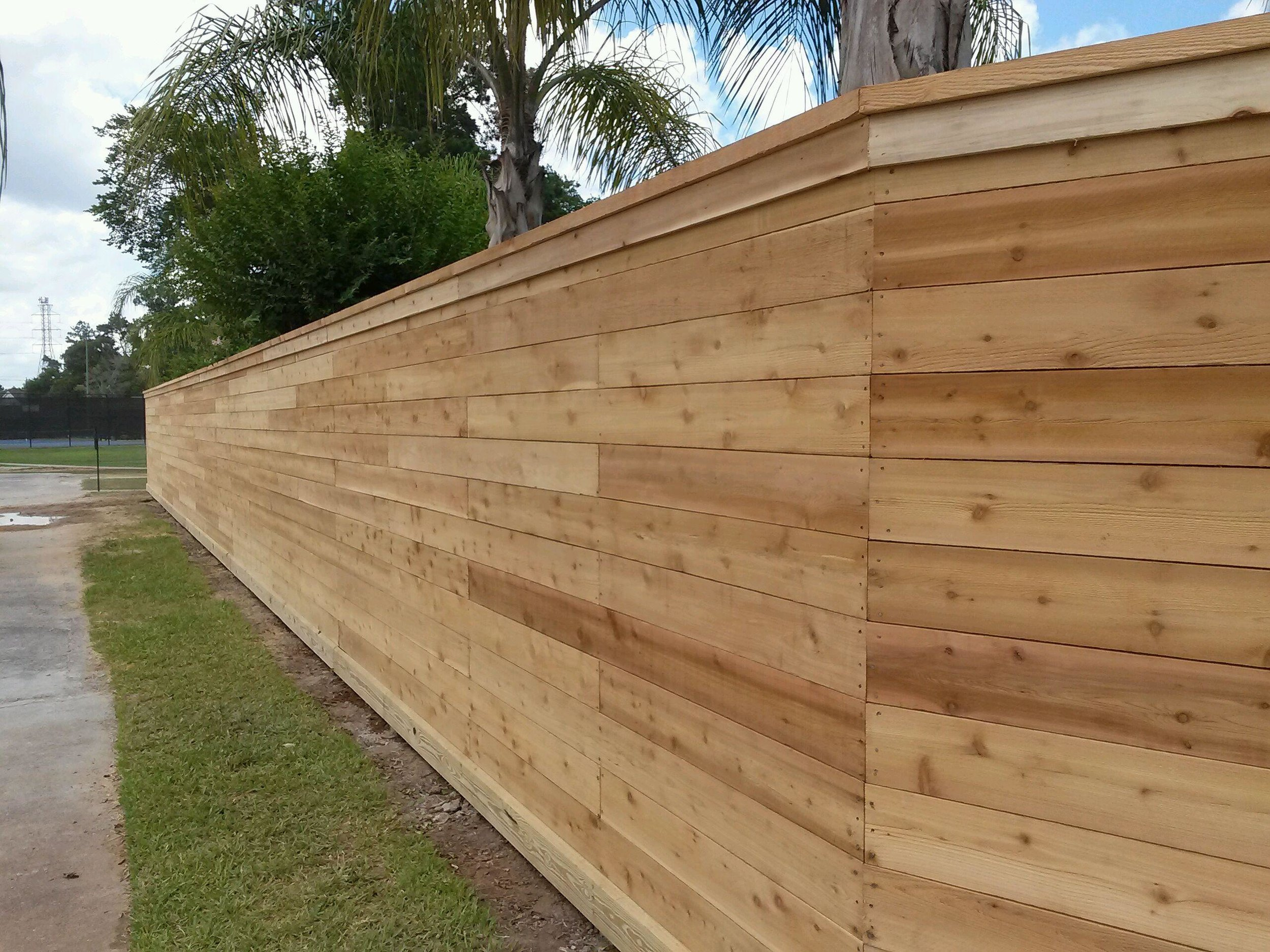 cedar privacy fence with horizontal boards and cedar cap and trim