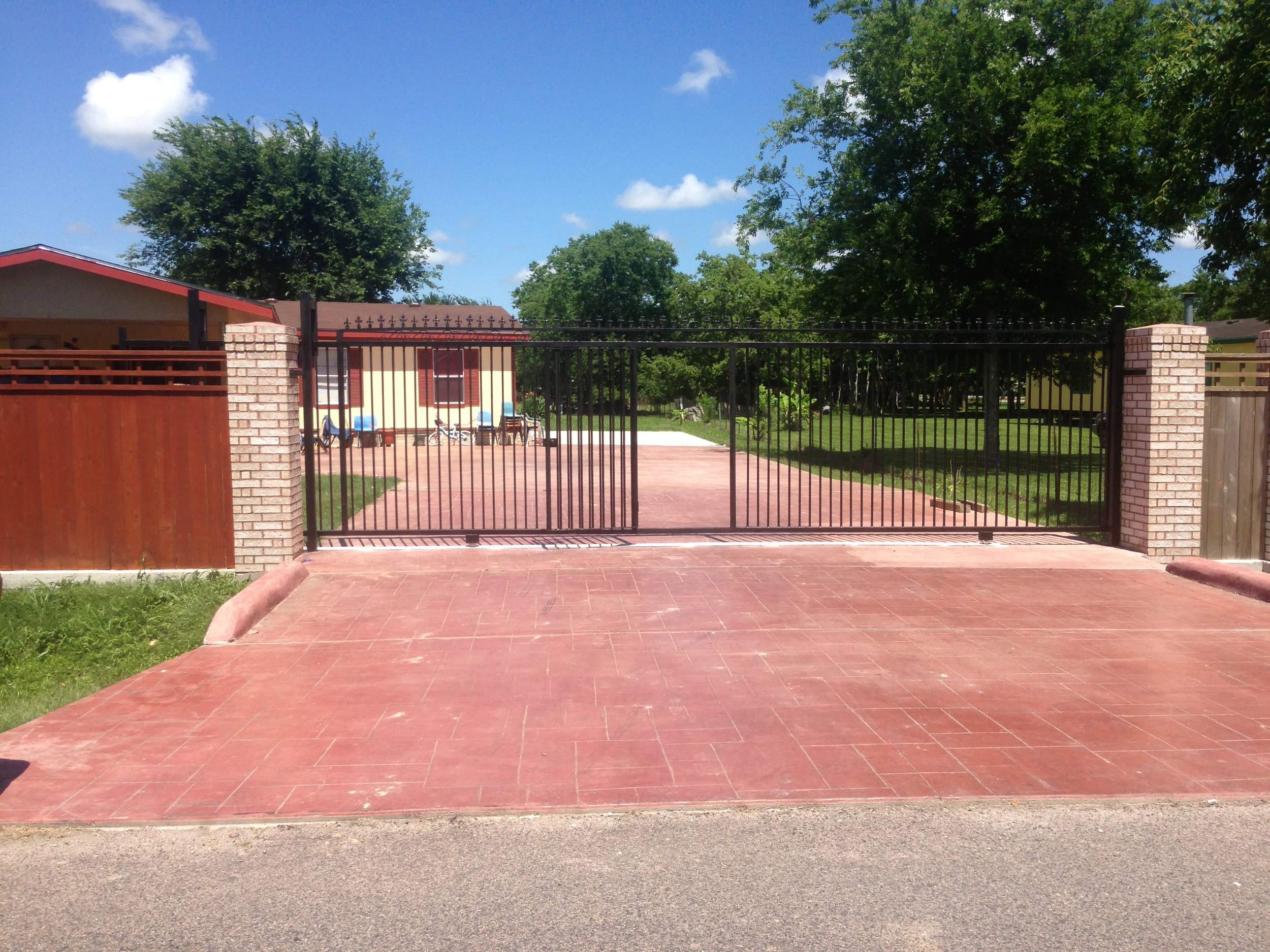 Remote access entry gate with brick columns