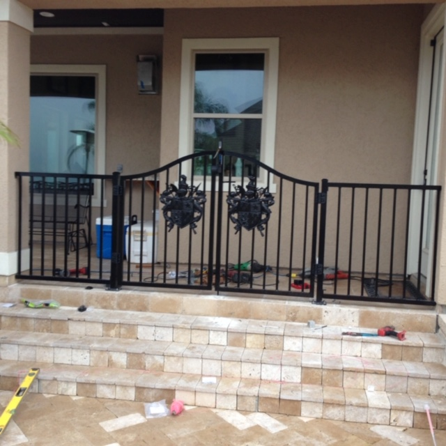 ornamental aluminum pool fence with arched gates