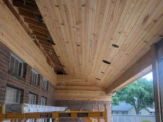 covered patio with tongue and groove ceiling during construction