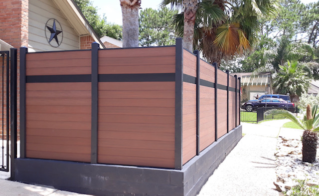 custom composite privacy fence on masonry wall