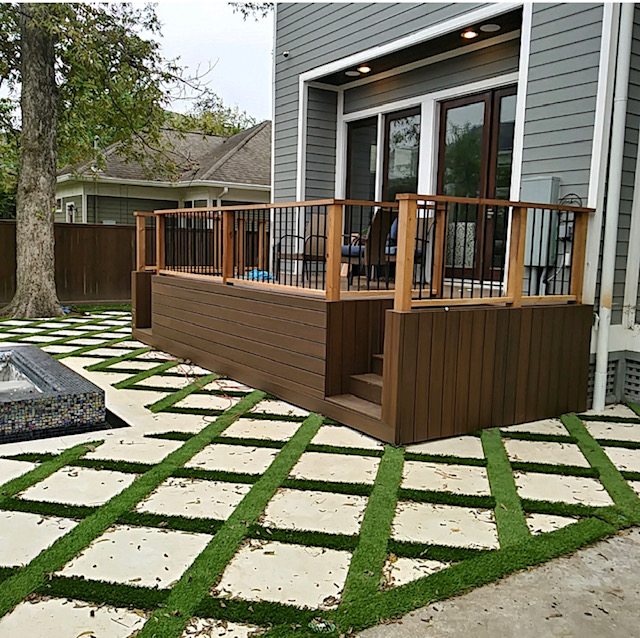 trex composite deck with cedar cap railing with metal spindles