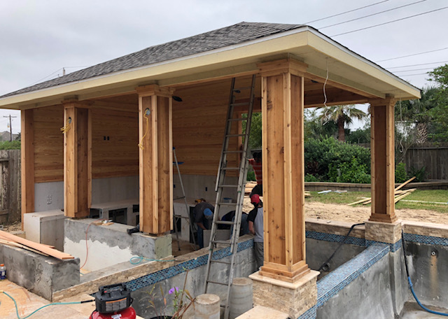 covered patio with outdoor kitchen during construction