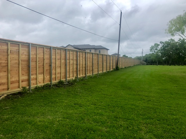 cedar privacy fence with galvanized steel posts during construction