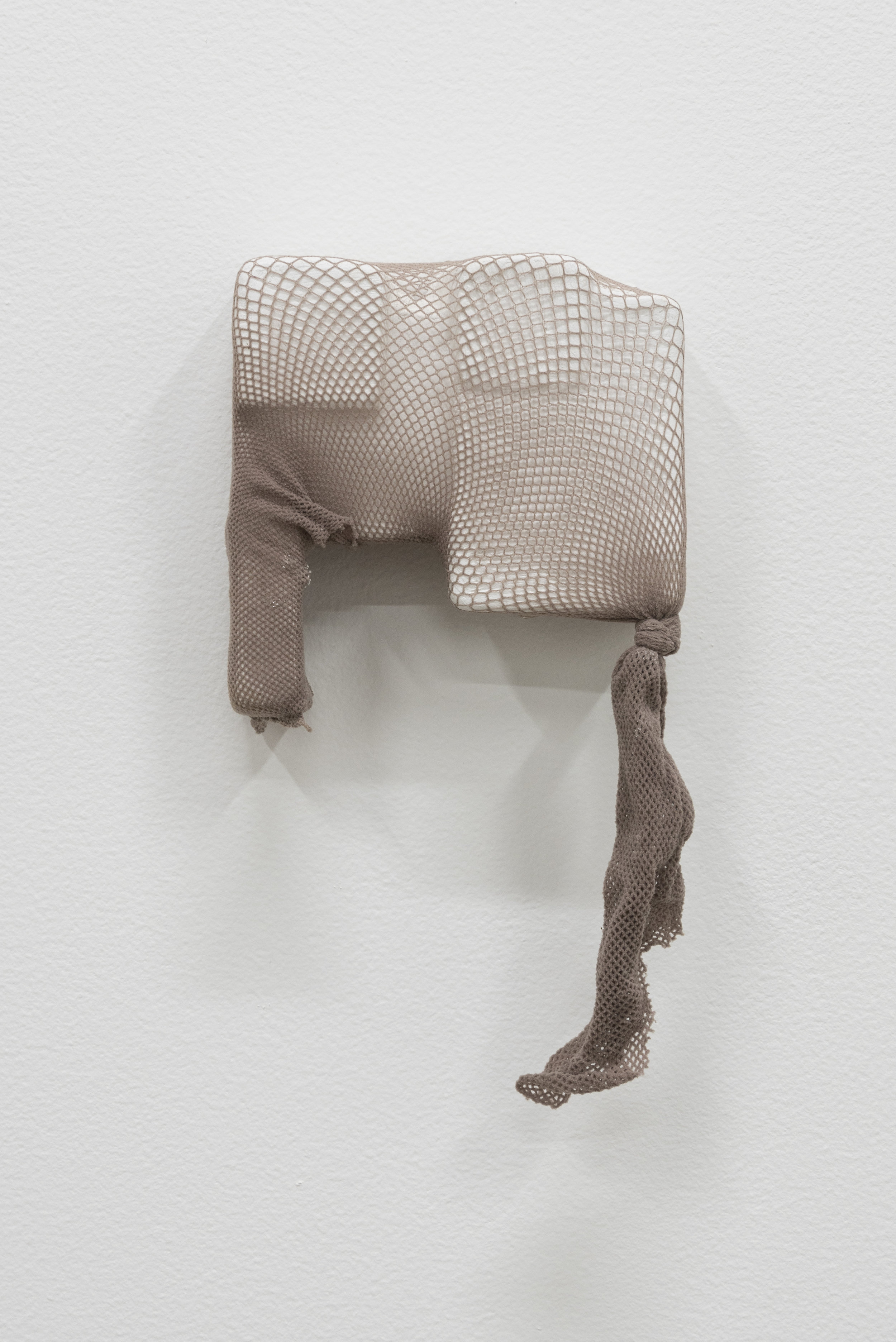 Sara Hubbs,  Closer, 2 018, plaster cloth, plaster and fishnet tights