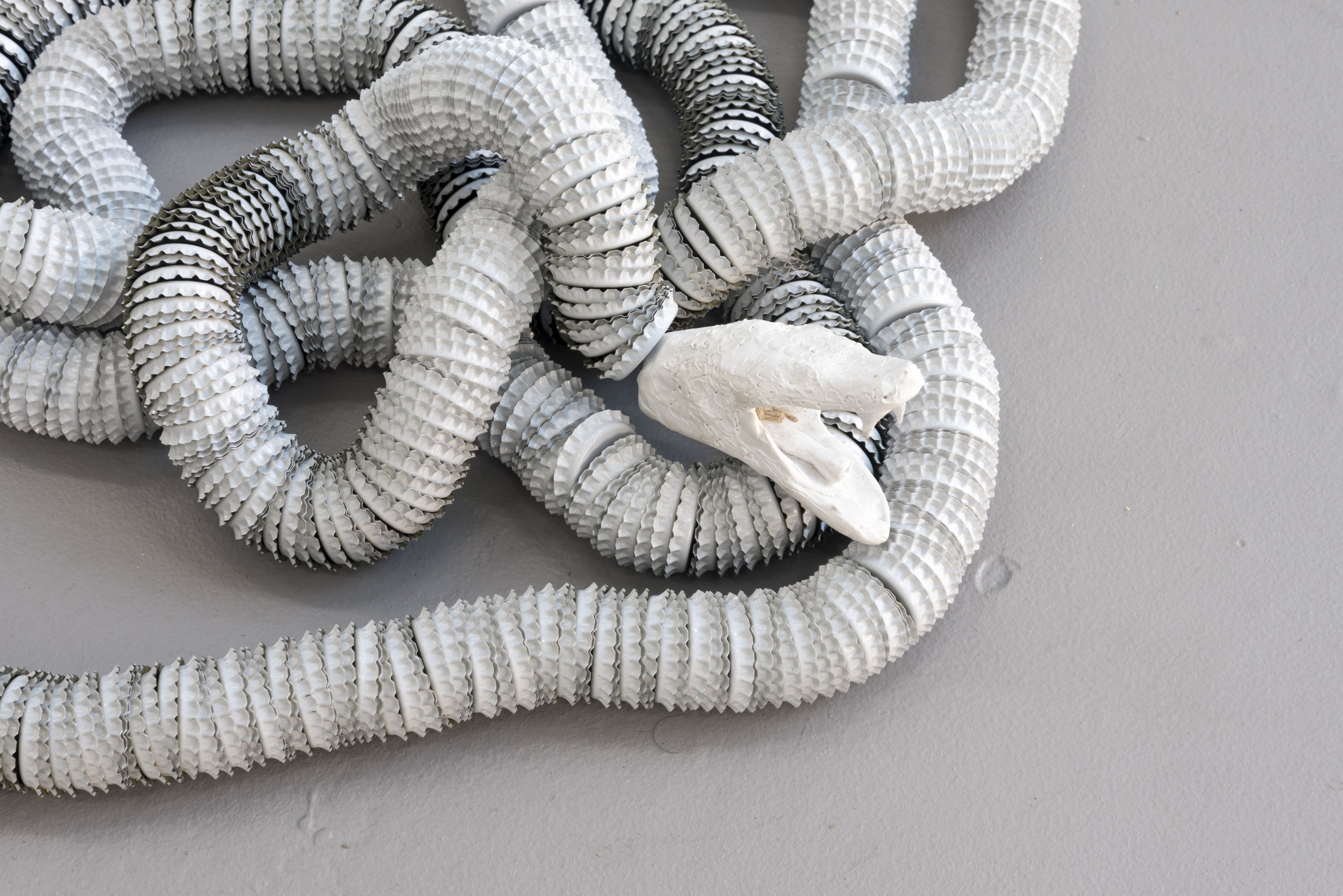 Preparing for the Unknown (Dream Snake),  2019 polymer clay, hemp string, bottle caps 20 feet long, installation dimensions variable