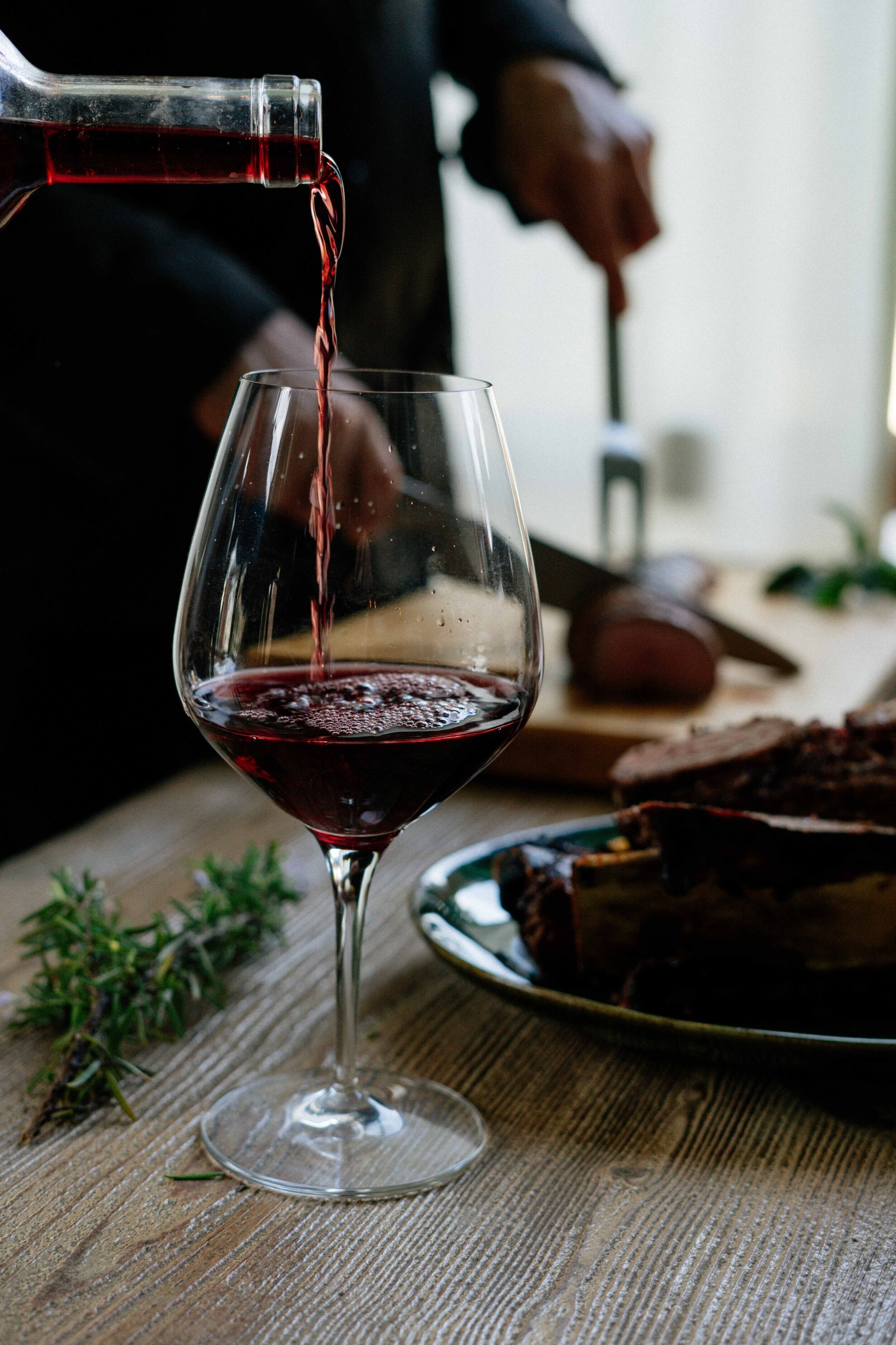 Pouring+red+wine+into+glass