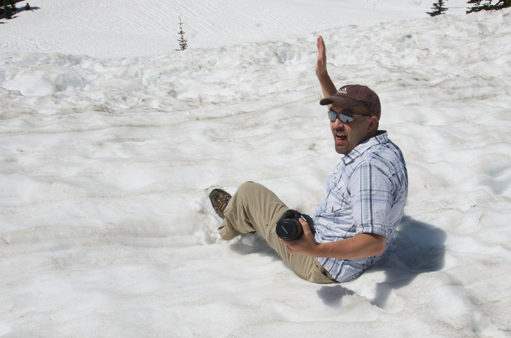 Leg stuck in snow, but the camera is safe (as am I).    Photo by  Ken Latman .