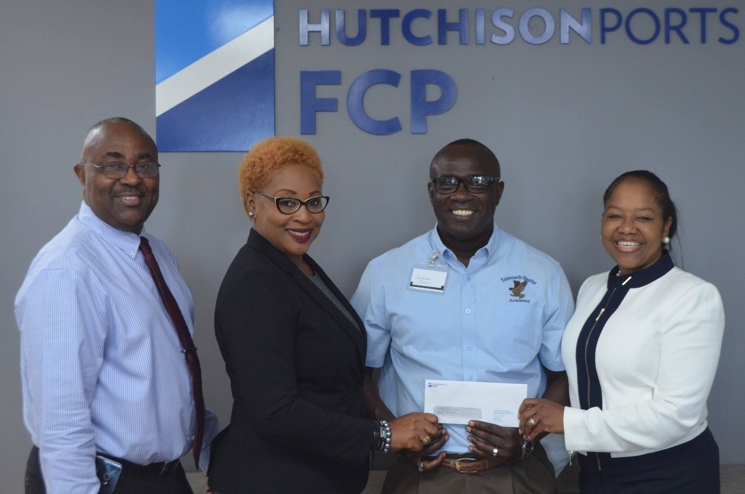 From Left to Right:  Captain Orlando Forbes, Port Director, Hutchison Ports FHC, Ms. Chanan Frtiz-Jones, Airport Director, Hutchison Ports, GBAC, Mr. Norris Bain, Deputy Administrator, Tabernacle Baptist Christian Academy and Sherry Brookes, Corporate\Government Affairs Director, Hutchison Ports FCP.