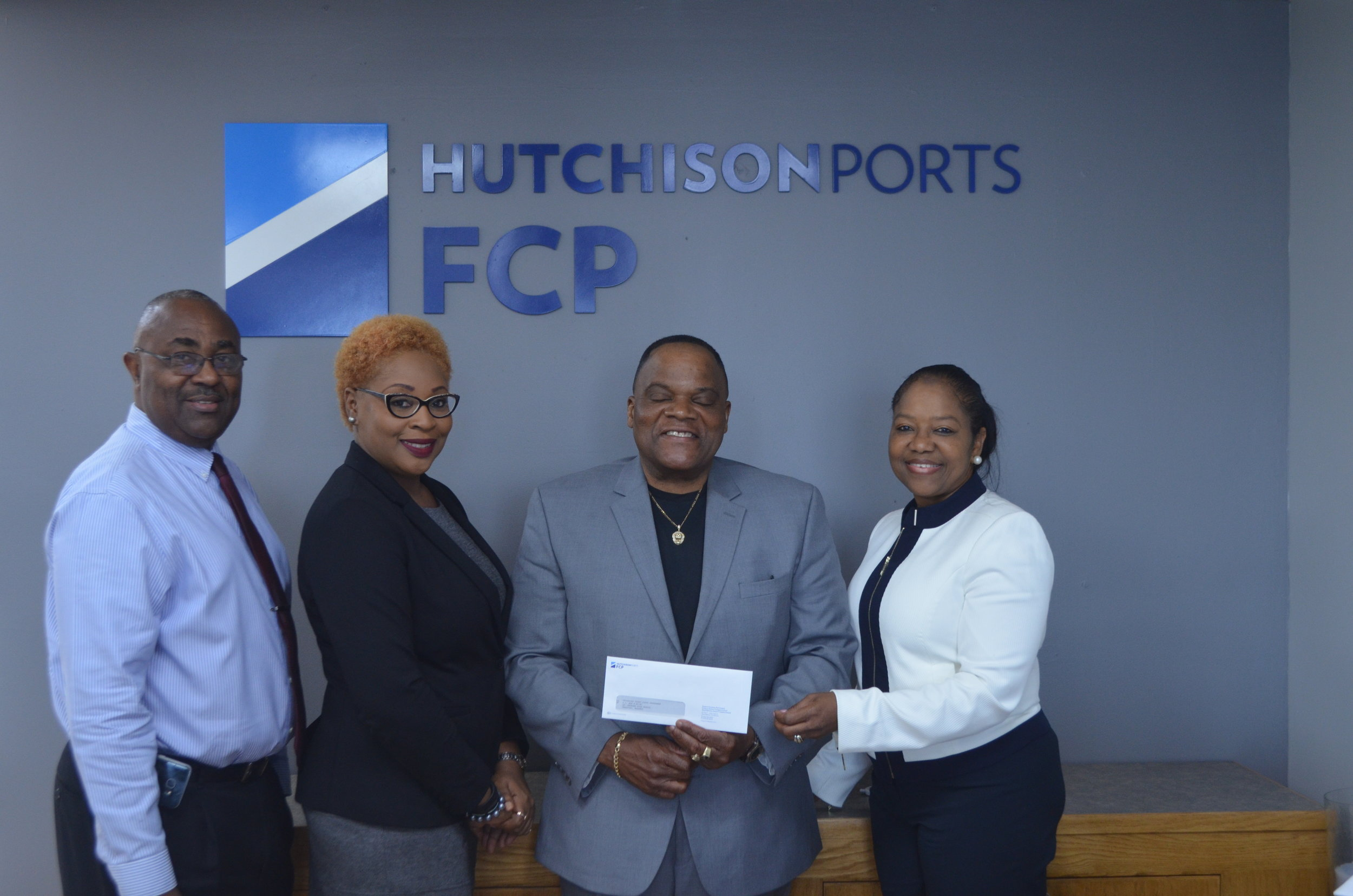 From Left to Right:  Captain Orlando Forbes, Port Director, Hutchison Ports FHC, Ms. Chanan Fritz-Jones, Airport Director, Hutchison Ports GBAC, Bishop Joseph Hall, Coordinator, Technical Cadet Corp Programme and Sherry Brookes, Corporate\Government Affairs Director, Hutchison Ports FCP.