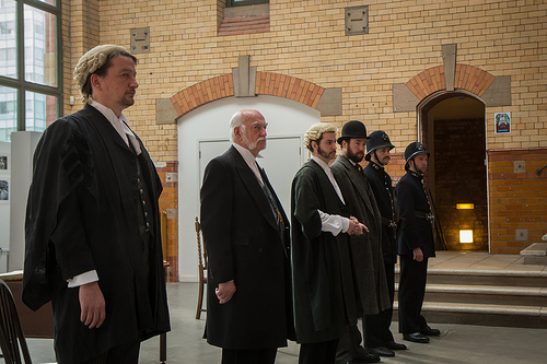 MARTIN GREEN AS MR COBBETT, JOHN SMEATHERS AS MAGISTRATE RICKARDS, GRAHAM EAGLESHAM AS MR NASH, MARK ROBERTS AS JEROME CAMINADA AND TWO CONSTABLES (GARETH GEORGE AND DAN JARVIS) (LEFT TO RIGHT)