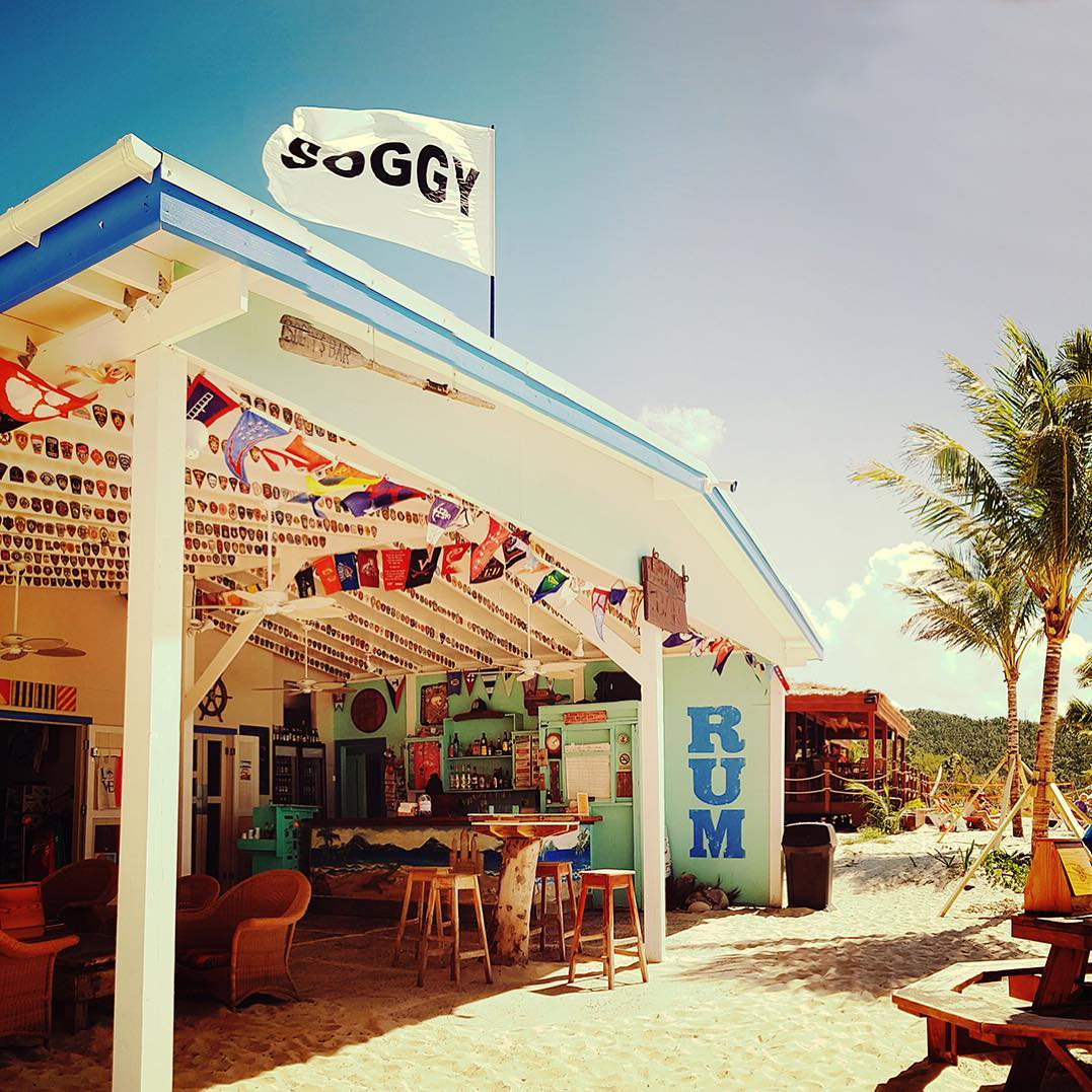 Soggy Dollar Bar - This iconic and well-known beach bar is just down the hill from Almost Heaven Villa on the beach of White Bay. Famous for the legendary