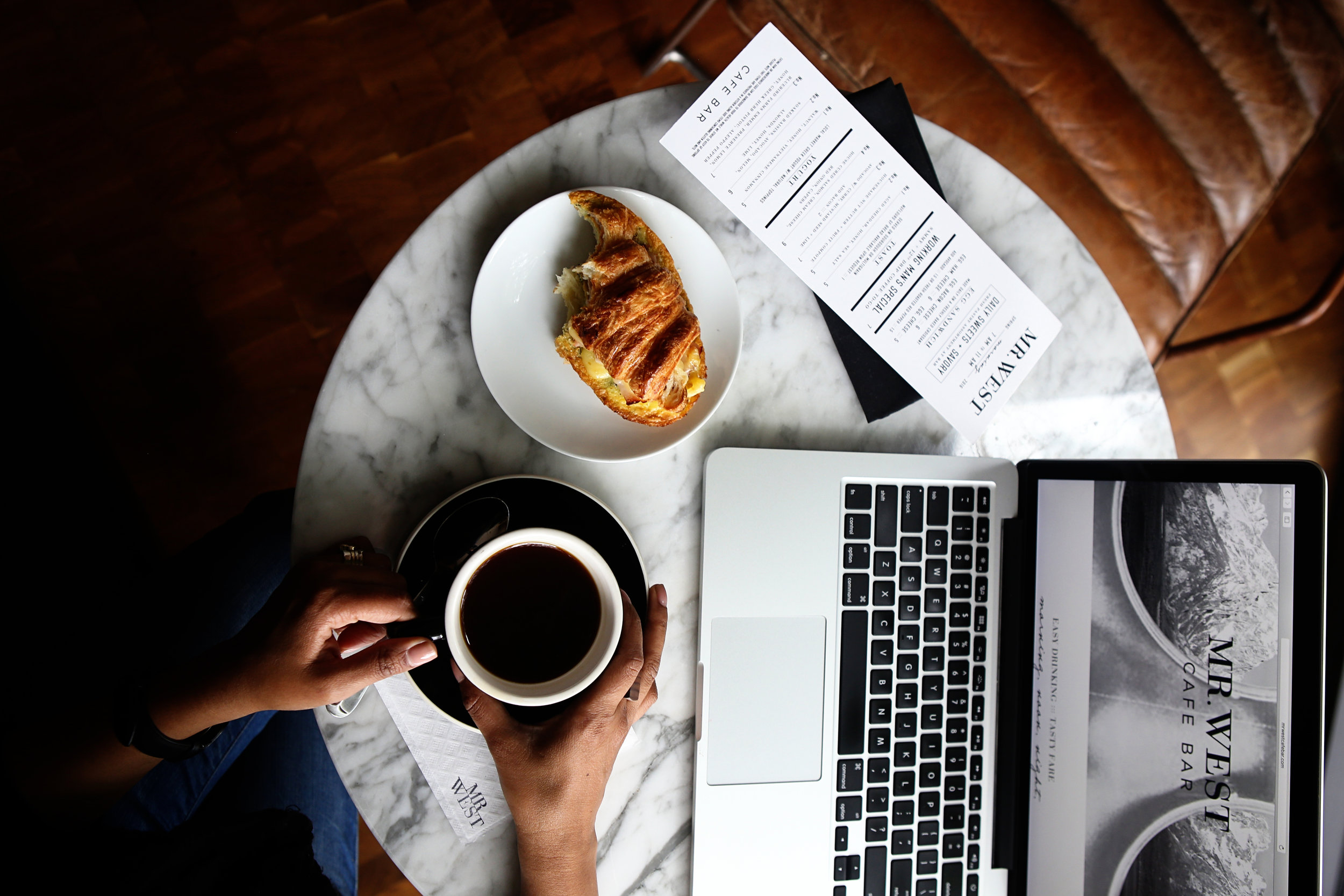 Canva - Macbook Pro and a Cup of Coffee on Table.jpg