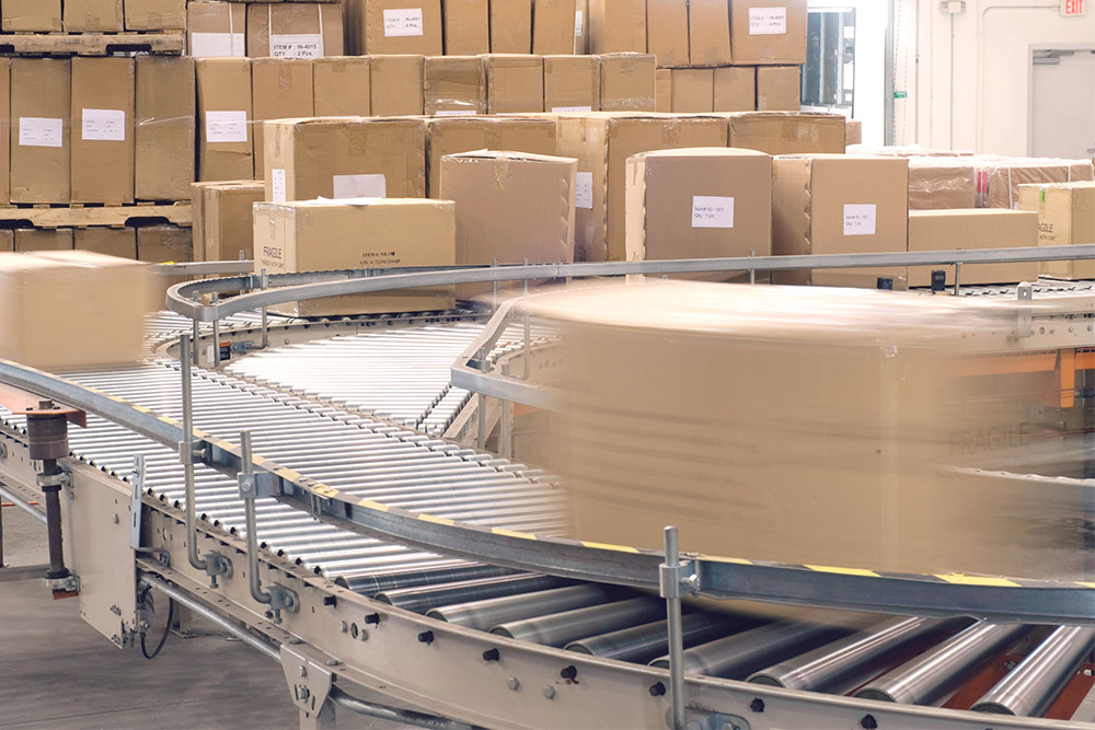 stac_conveyor_gallery_bigstock-Cardboard-boxes-on-conveyor-be-194364376.jpg