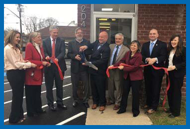 The Sonostics staff celebrates the opening of their new offices in Endicott, N.Y. in December, 2016. With them are officials from the Greater Binghamton Chamber of Commerce.