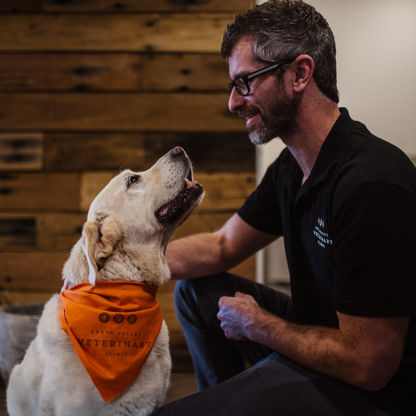 Dr Joh & dog at Vet Clinic