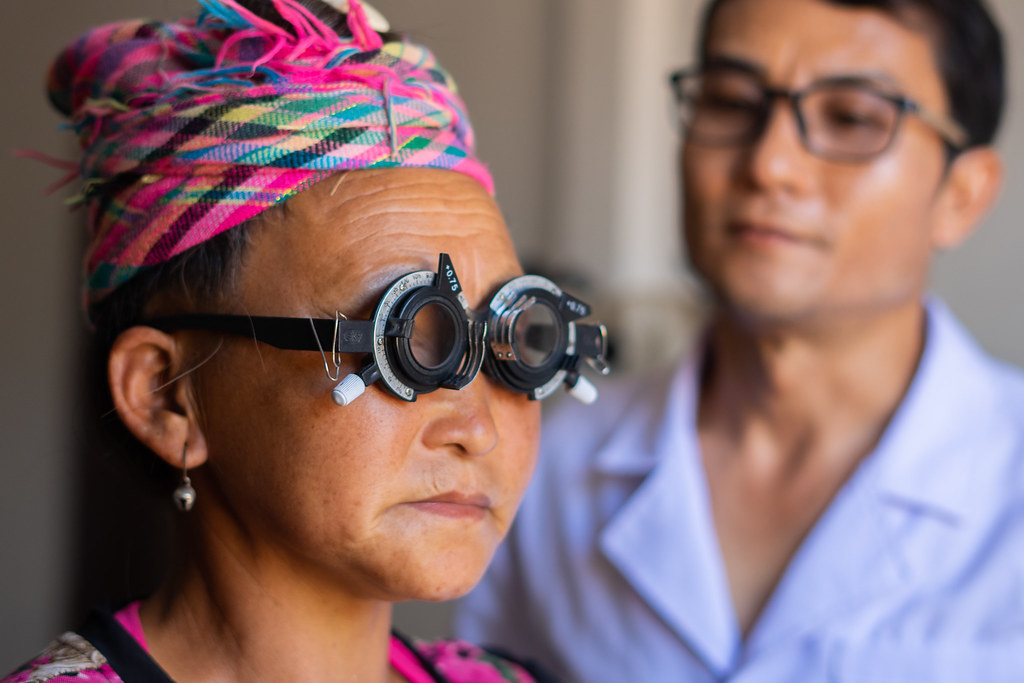 Optometrist and ophthalmic nurse Khamthan Amath looks for the right prescription for Pa, 49, from the Hmong ethnic minority of Lao PDR. With the right prescription glasses, Pa will be able to see clearly again.//Pa, like many people f rom ethnic minori  Submitted by: Aildrene Israel Tan