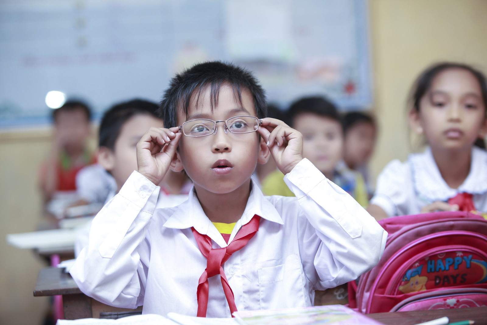 A child surprised to see clearly after wearing new glasses  Submitted by: Nguyen Thi Quynh Nhu