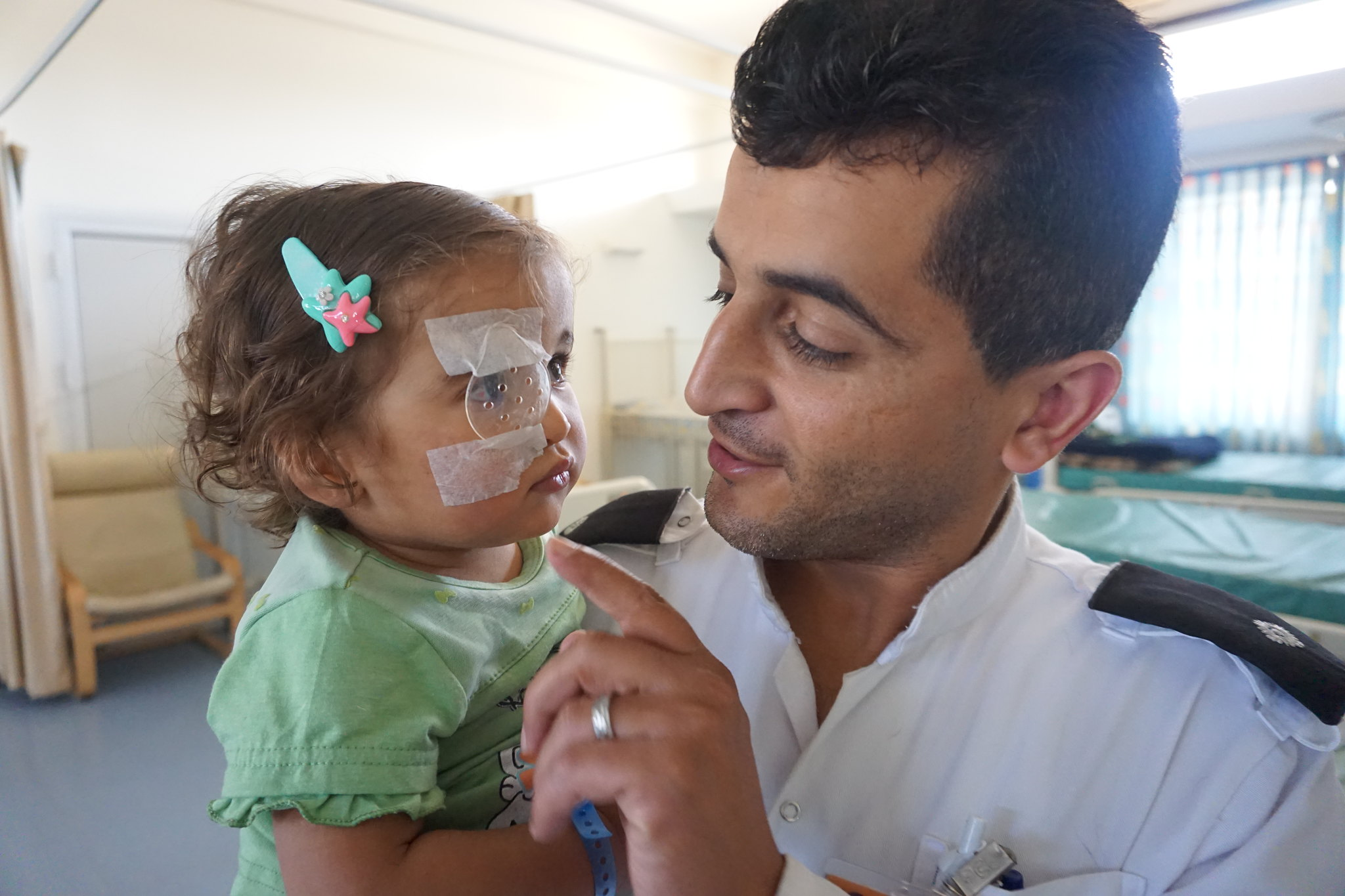 "'Nothing can replace a mother's love when a child is sick, but we try our best to fill that gap."" St John Jerusalem Eye Hospital nurses take extra care of Gazan child patients who are often not allowed to come with their primary care givers due to permit  Submitted by: Marie-Claire Boyle"