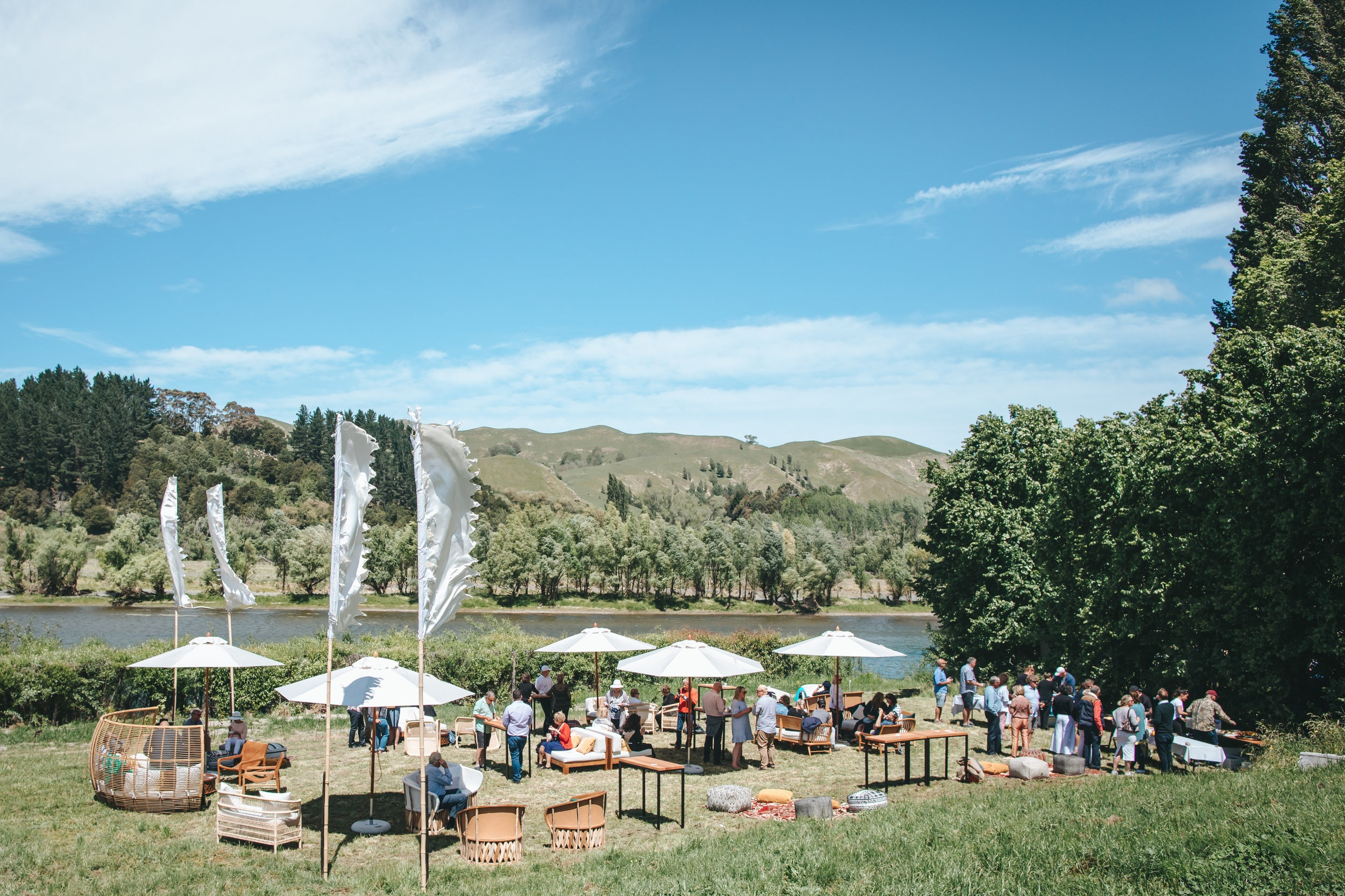 Black Barn Vineyards & Al Brown Secret Location Lunch - A seated area for 200 guests along the Tuki River in Hawke's Bay.