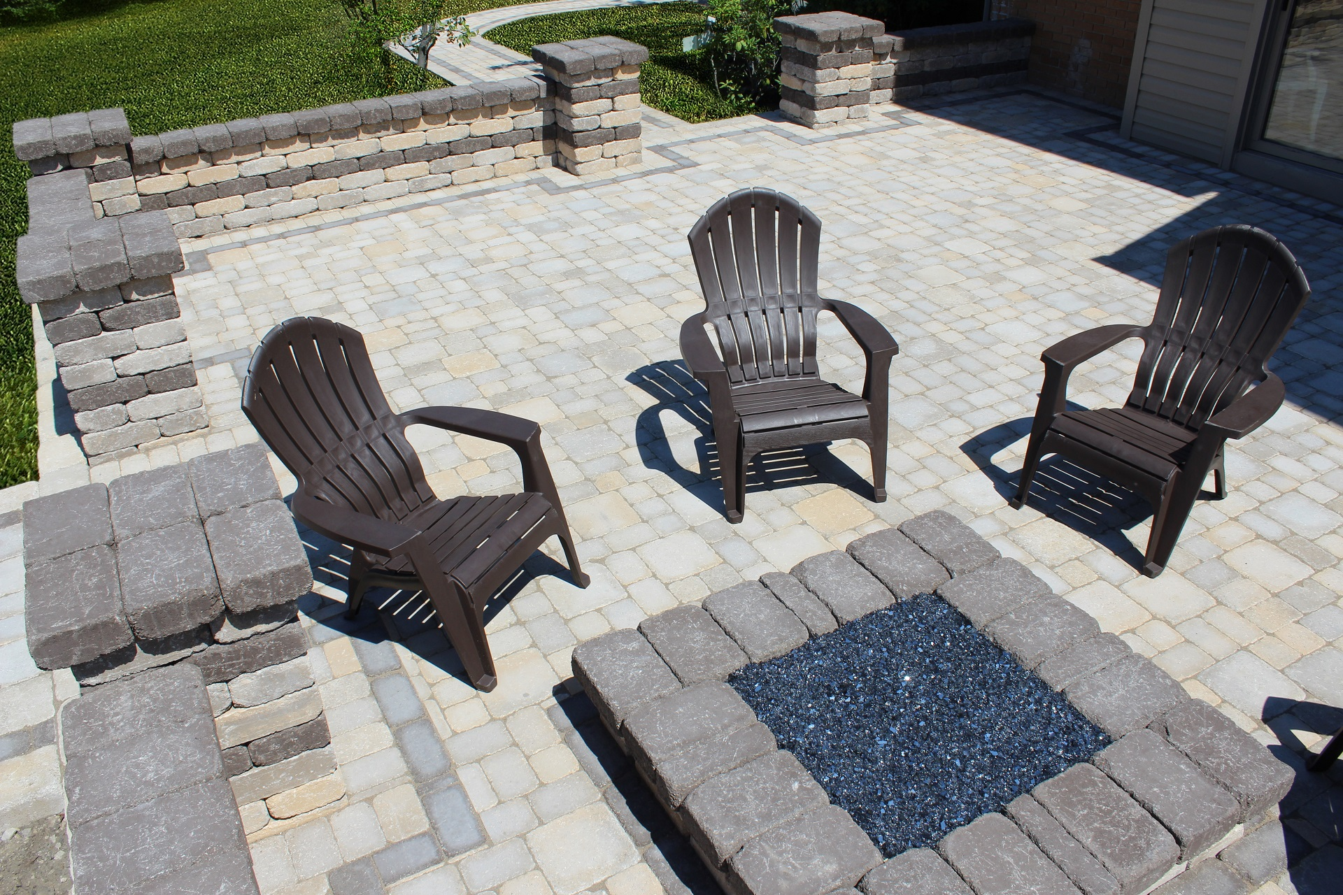 Brick patio with outdoor fireplace in Flat Rock MI