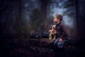 little-boy-in-the-woods-with-teddy-300x200.jpg