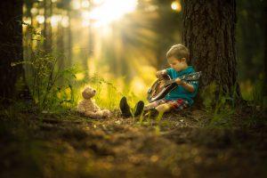 little-boy-playing-music-for-teddy-300x200.jpg
