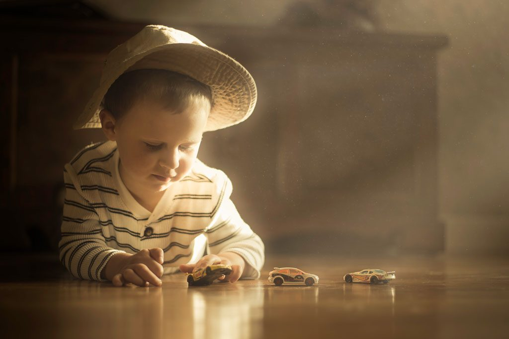 little-boy-playing-with-boxcars-1024x683.jpg
