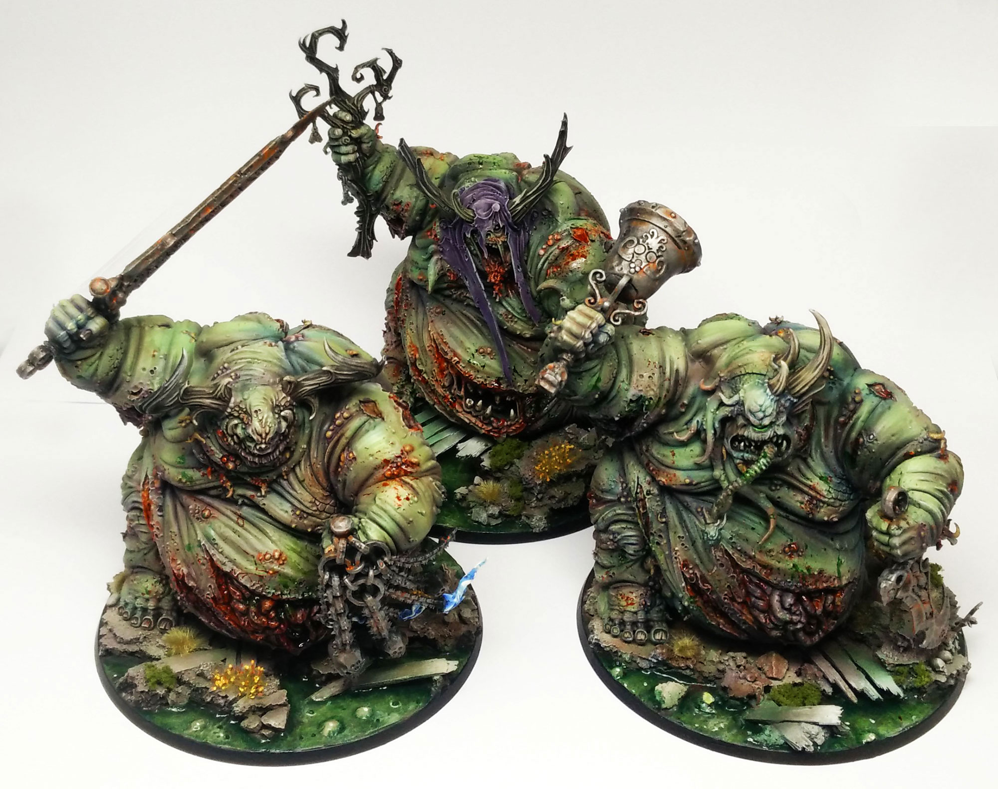 A triumvirate of Nurgle Great Unclean Ones, on swamp bases to add to the atmosphere of blight and decay!