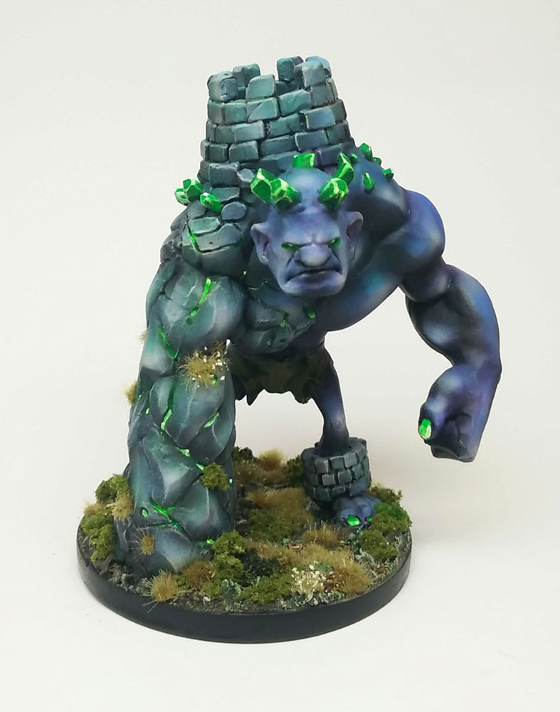 A polystone alternate chess piece, a Rook, painted to fit into an Age of Sigmar army as an Aleguzzler Gargant alternative.