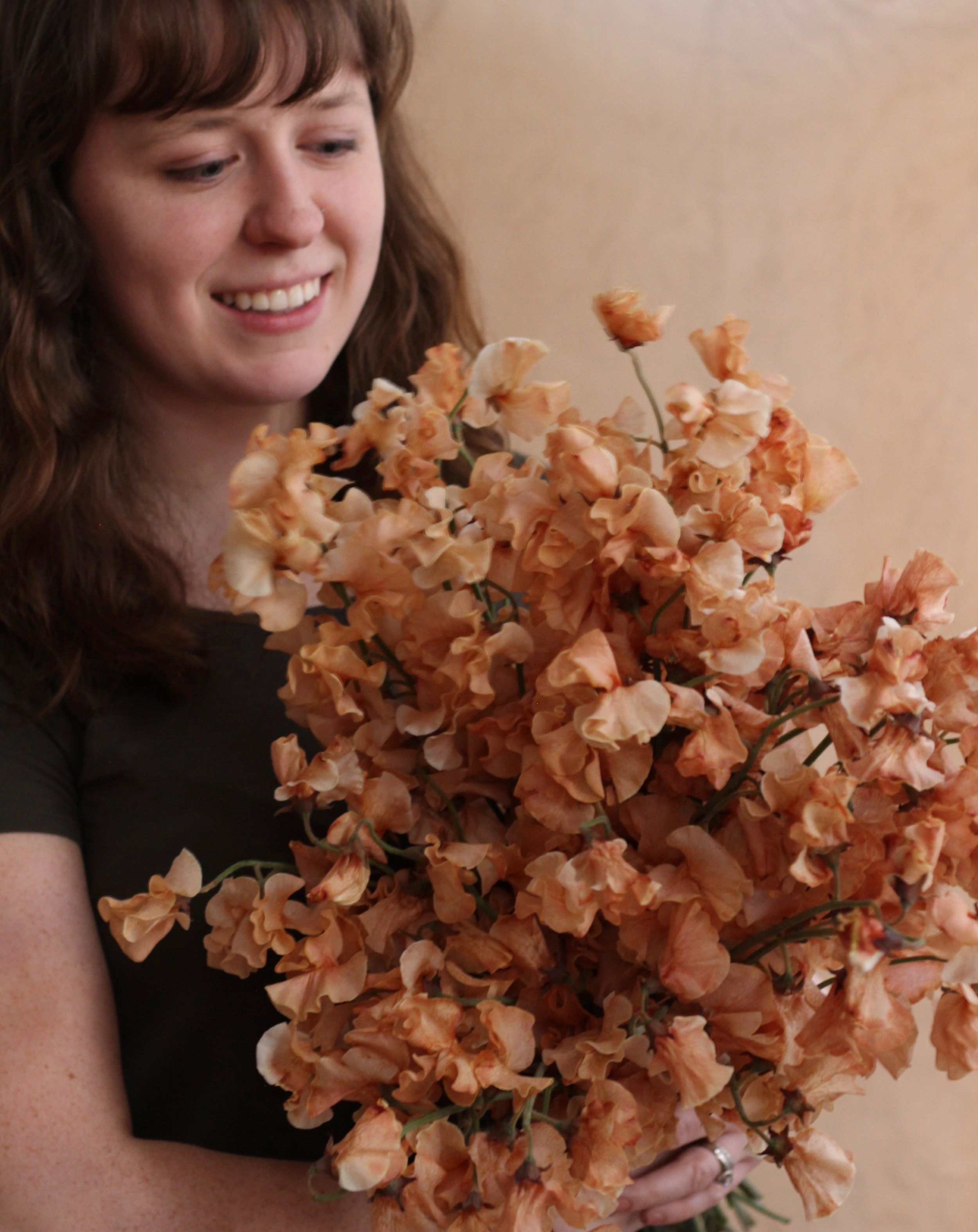 the designer - Hi! I'm Meagan, the heart and hands behind Meadow House. In a city known for its hustle and bustle, I love sharing flowers as a way to inspire pause, reflection, and celebration.With each design or service, I have one goal: to touch the heart of the recipient in a way that shows them they are known, seen, and deeply loved.