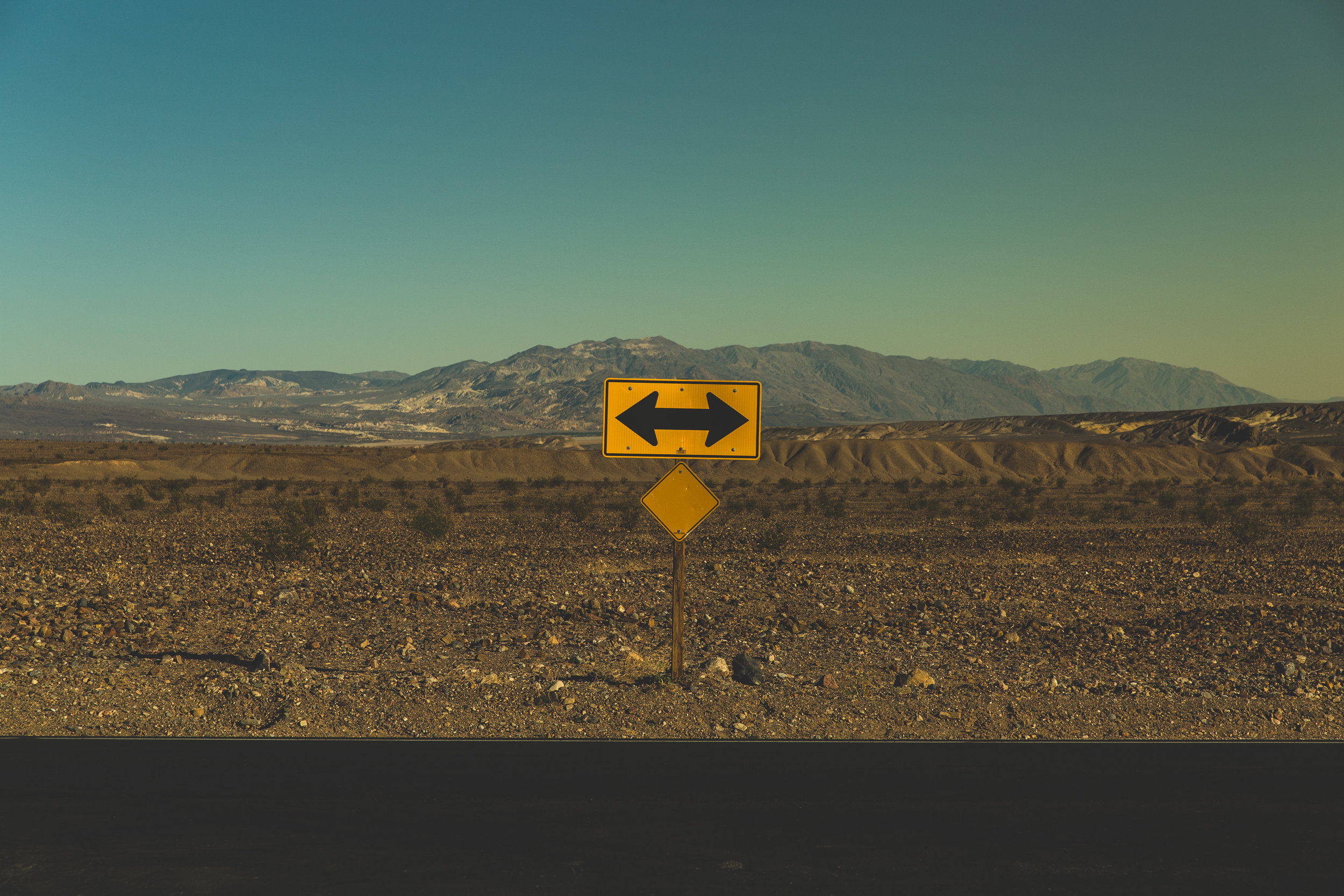 Sign with arrows in Death Valley National Park