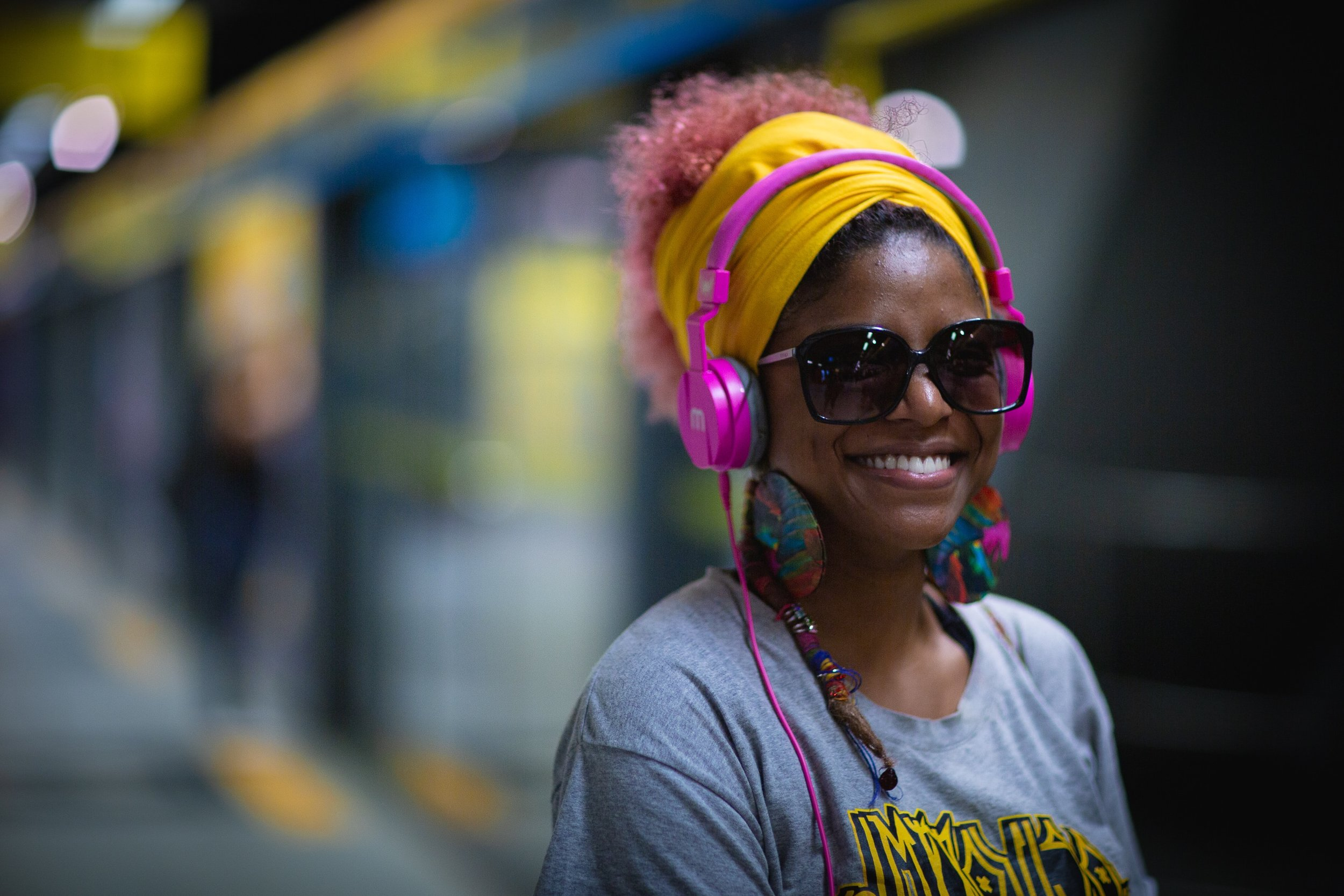 A person wearing headphones and smiling
