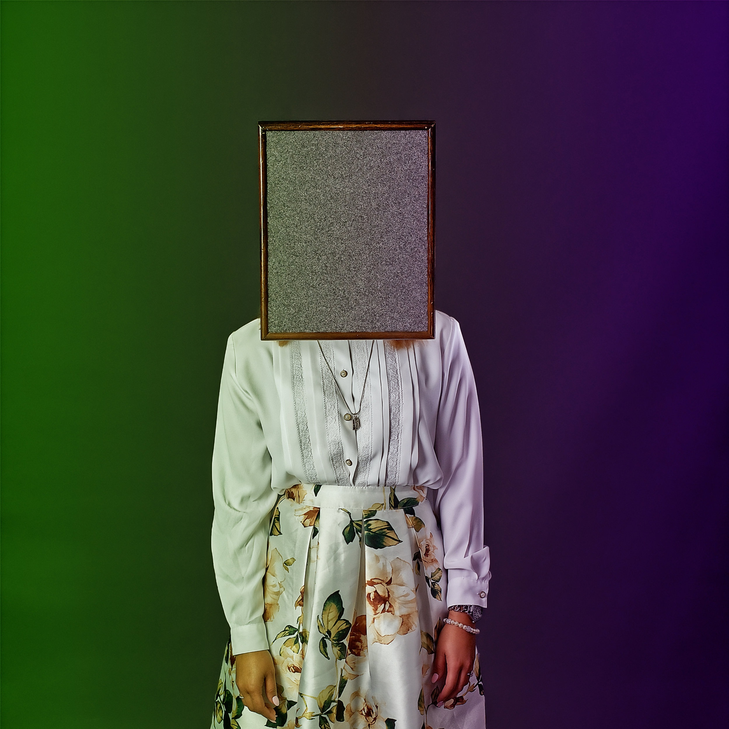 Person with a square of static obscuring their head
