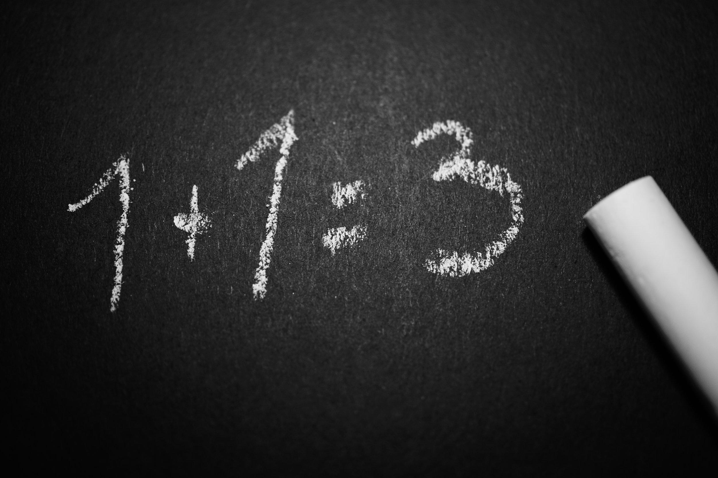 """Chalkboard reading """"1 + 1 = 3"""""""