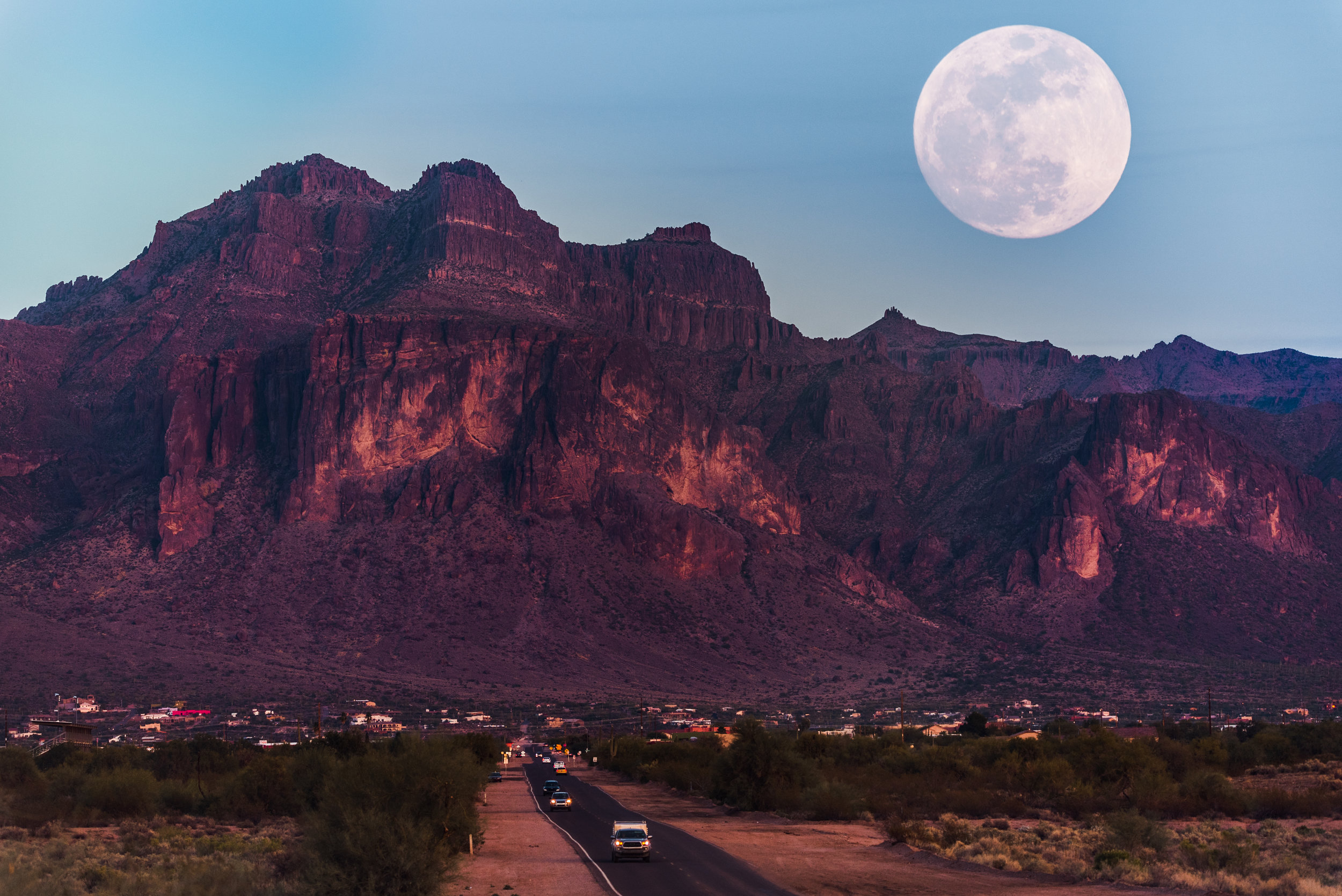 A full moon rising over Superstition Mountains, Arizona, USA