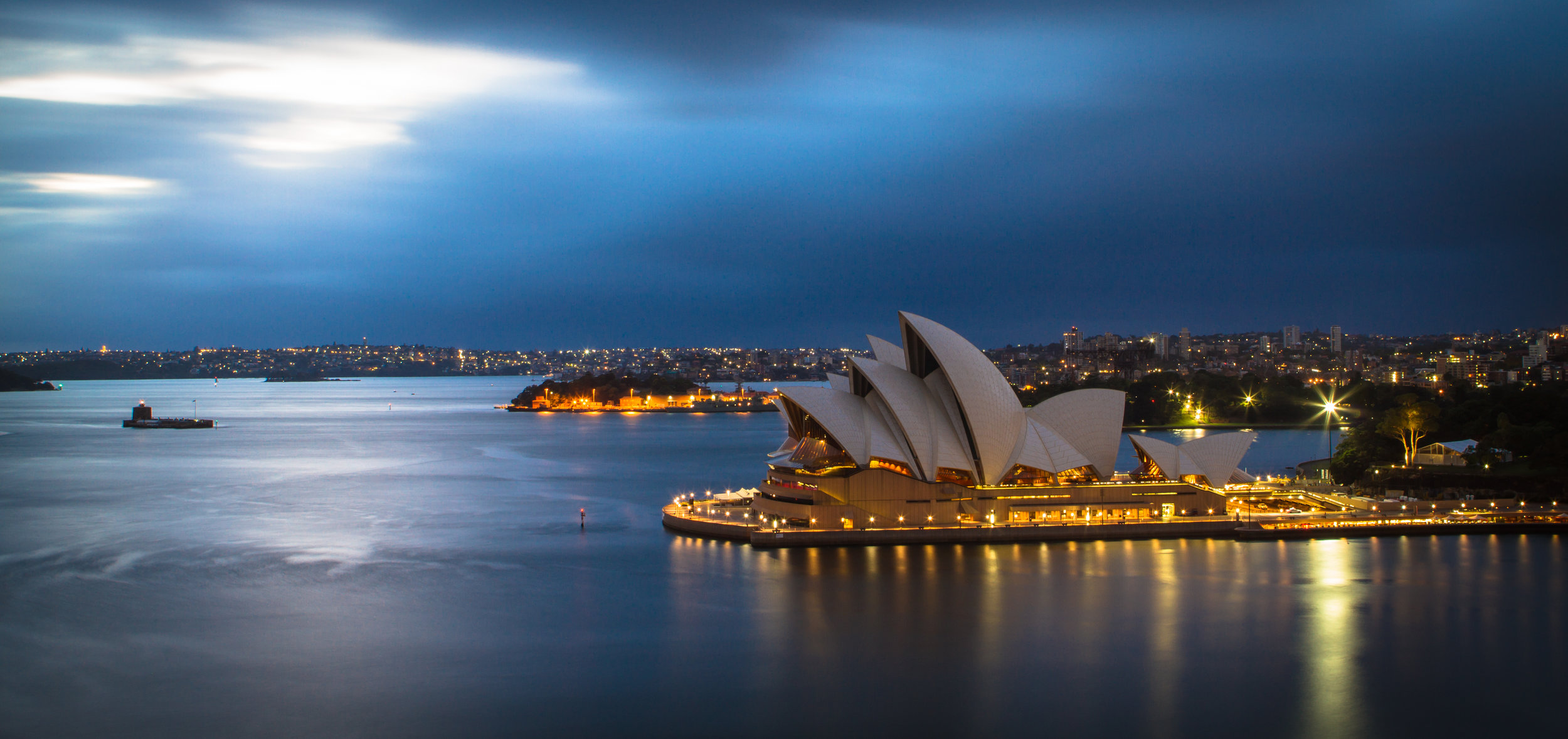 Nighttime view across Sydney harbour, including the Opera House