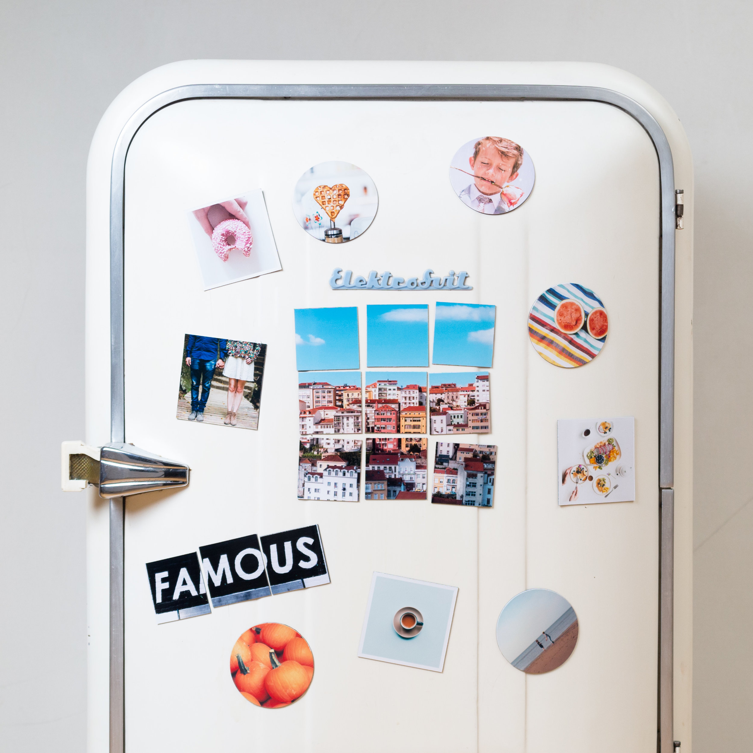 A refrigerator with lots of magnets on
