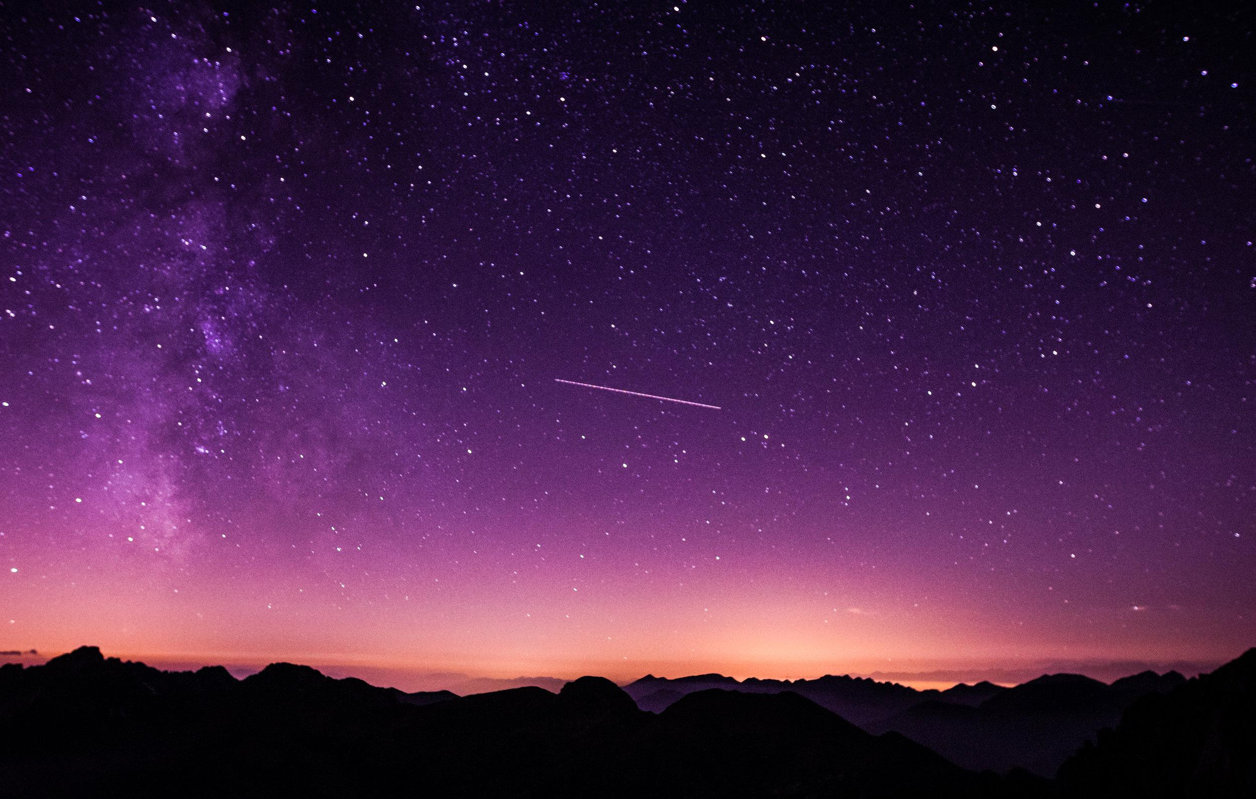 A meteor crossing a starry night sky